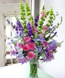 Tall arrangement that is sure to please anyone!