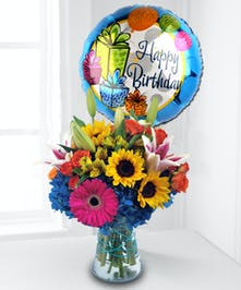 This bouquets feature colorful seasonal flowers complimented with a large birthday mylar balloon.