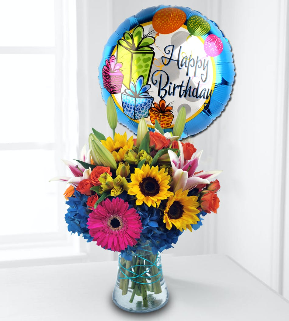 This Bouquets Feature Colorful Seasonal Flowers Complimented With A Large Birthday Mylar Balloon