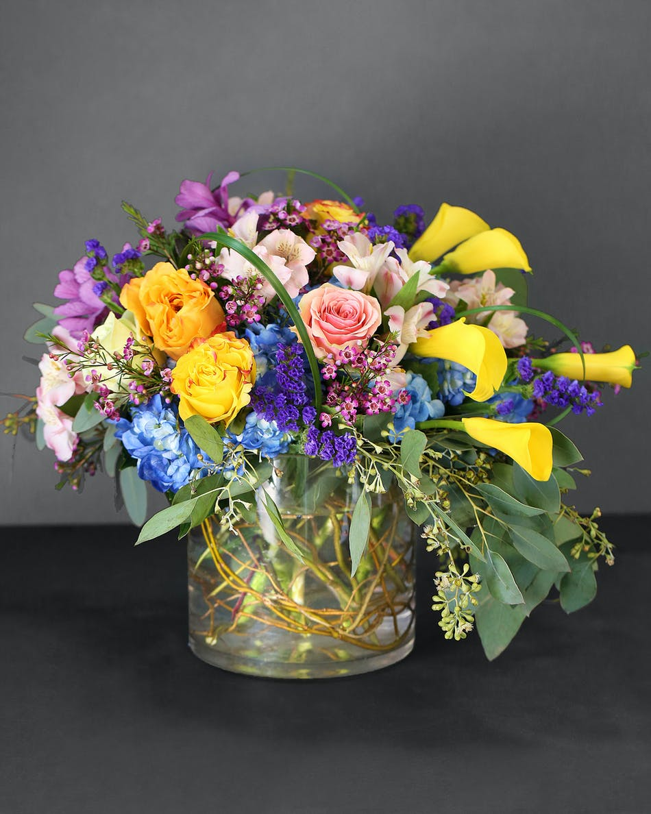 Spring color flowers orlando fl in bloom florist yellowpeachpink roses yellow calla lilies blue hydrangea white mightylinksfo