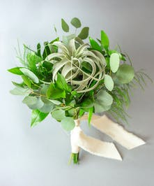 Make a statement at your upcoming prom or homecoming dance with the Delicate Greens Petite Bouquet!