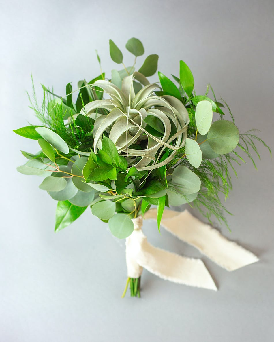 Flower bouquet for prom and homecoming in bloom florist orlando make a statement at your upcoming prom or homecoming dance with the delicate greens petite bouquet izmirmasajfo