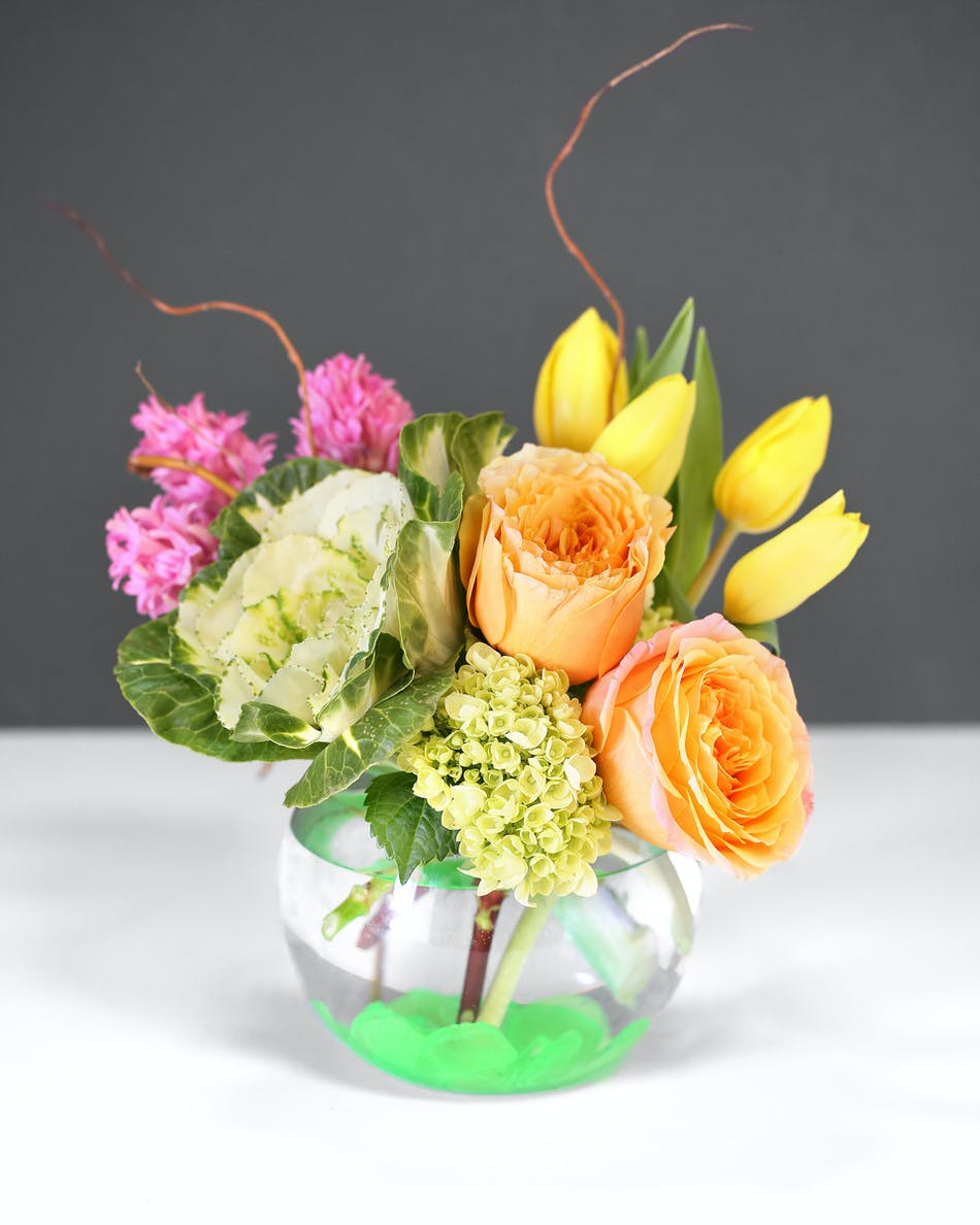 Easter blessing spring flowers orlando fl in bloom florist fragrant hyacinth blooms are paired with vibrant tulips roses and daffodils and gracefully designed izmirmasajfo