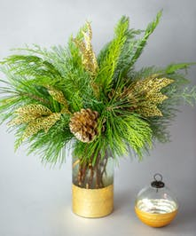 Paired with a keepsake matching ornament, this arrangement is the perfect way to celebrate the season.