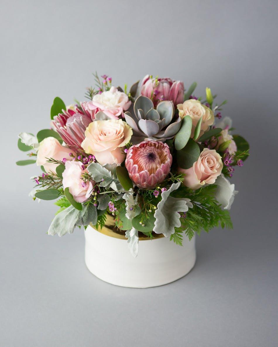Protea succulent arrangement orlando heathrow fl dusty miller pink roses roses succulent succulents protea wax flower izmirmasajfo