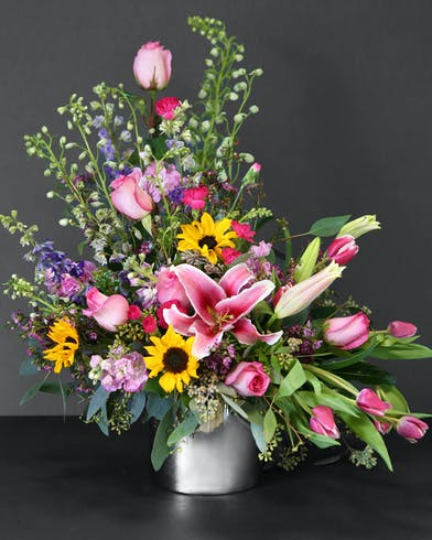 We combine roses, lilies, tulips, sunflowers, and more, to create a bouquet of wondrous beauty and elegance.