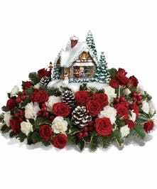 Complete your collection with this joyful bouquet of red roses, white carnations, holly and noble fir to create a winter wonderland