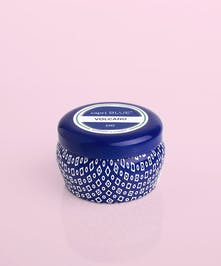 This Volcano Mini Tin is small enough to throw in your purse, so you can take the iconic scent with you no matter what!